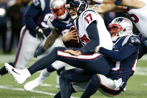 Houston Texans quarterback Brock Osweiler (17) is sacked by New England Patriots cornerback Logan Ryan (26) during the first quarter of an AFC Divisional Playoff game at Gillette Stadium on Saturday, Jan. 14, 2017, in Foxborough. ( Brett Coomer / Houston Chronicle )