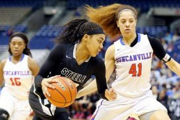 Steele's Antonia Anderson drives around Duncanville's Madison Townley during first-half action of their Class 6A state semifinal girls basketball game held Friday March 4, 2016 at the Alamodome. (Staff photo)