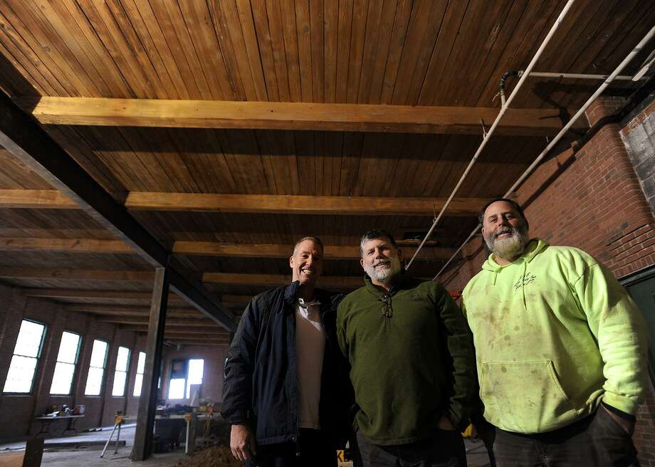 From left; Owners John Walsh, of Orange, and brothers Bill and Mark daSilva, of Shelton, are working to open their Bad Sons Beer Company brewery and tasting room at 249 Roosevelt Drive in Derby, Conn. on Wednesday, January 18, 2017. Photo: Brian A. Pounds / Hearst Connecticut Media / Connecticut Post