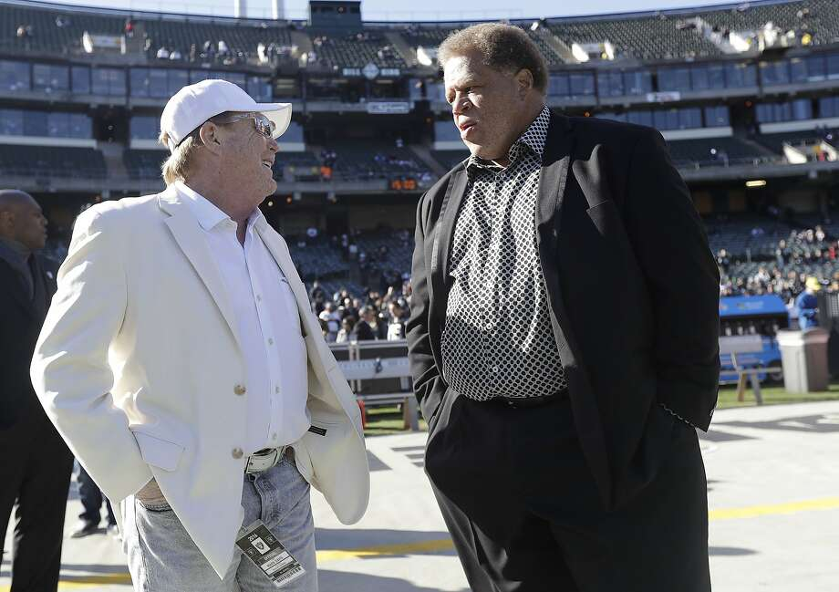 Raiders GM Reggie McKenzie (right, with owner Mark Davis), is the Pro Football Writers of America's top executive. Photo: Marcio Jose Sanchez, Associated Press