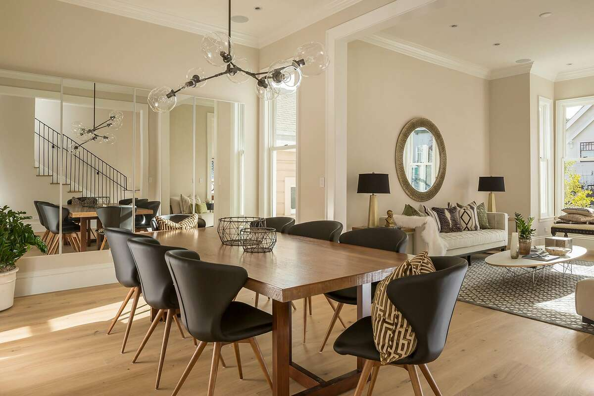 A formal dining area stands beyond the main entrance.