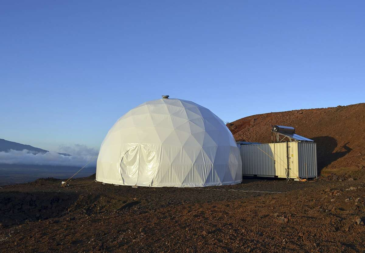 This April 25, 2013 photo provided by the University of Hawaii at Manoa shows the domed structure that will house six researchers for eight months in an environment meant to simulate an expedition to Mars, on Mauna Loa on the Big Island of Hawaii. The group will enter the geodesic dome Thursday, Jan. 19, 2017, and spend eight months together in the 1,200 square foot research facility in a study called Hawaii Space Exploration Analog and Simulation (HI-SEAS). They will have no physical contact with any humans outside their group, experience a 20-minute delay in communications and are required to wear space suits whenever they leave the compound. (Sian Proctor/University of Hawaii at Manoa via AP)