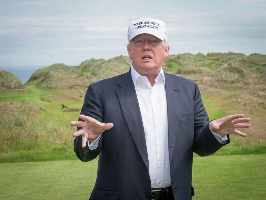 President-elect Donald Trump speaks to members of the media during a June tour of his International Golf Links course north of Aberdeen on the east coast of Scotland. His company confirms plans to expand the golf resort, raising concerns about conflicts of interest. Photo: AFP /Getty Images /File Photo / AFP or licensors
