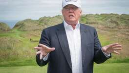 President-elect Donald Trump speaks to members of the media during a June tour of his International Golf Links course north of Aberdeen on the east coast of Scotland. His company confirms plans to expand the golf resort, raising concerns about conflicts of interest.