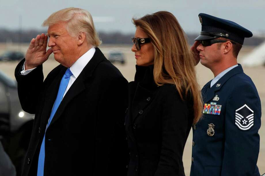 President-elect Donald Trump salutes as he and his wife Melania arrive at Andrews Air Force Base, Md., Thursday, Jan. 19, 2017, ahead of Friday's inauguration. Photo: Evan Vucci, AP / Copyright 2017 The Associated Press. All rights reserved.