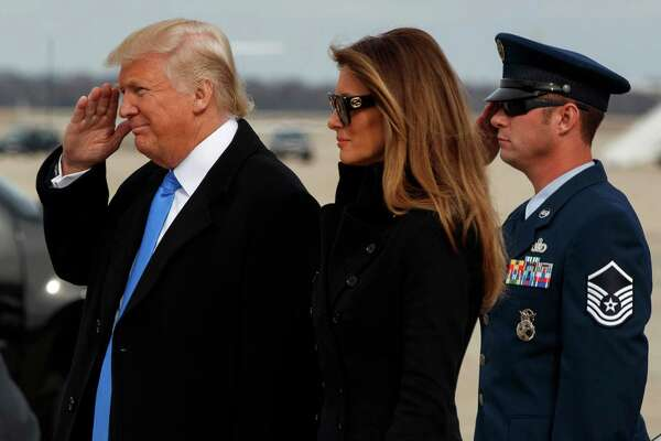 President-elect Donald Trump salutes as he and his wife Melania arrive at Andrews Air Force Base, Md., Thursday, Jan. 19, 2017, ahead of Friday's inauguration.