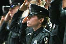 New Colonie Police Officer Amanda Paris salutes as 42 new police officers and deputy sheriffs representing 17 agencies graduate Zone 5 Regional Law Enforcement Training Academy's commencement exercises for Session 61 of the Basic Course for Police Officers at Proctors Theater Thursday Jan. 19, 2017 in Schenectady, NY.  (John Carl D'Annibale / Times Union)