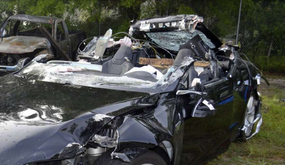 FILE - In this photo provided by the National Transportation Safety Board via the Florida Highway Patrol, a Tesla Model S that was being driven by Joshua Brown, who was killed when the Tesla sedan crashed while in self-driving mode on May 7, 2016.