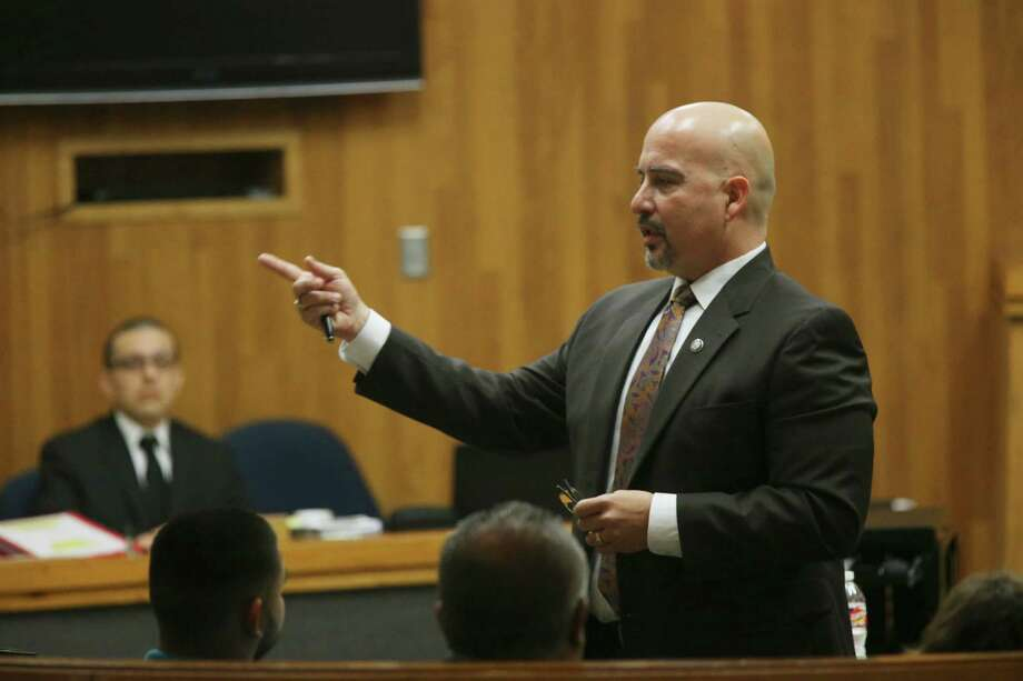 U.S. Border Patrol Agent Joel Luna's, back left, attorney Carlos A. Garcia gives his opening statement in Luna's capital murder trial in Brownsville, Texas, Wednesday, Jan. 18, 2017. Luna, 30, was charged along with his two brothers, Eduardo Luna Rodriguez, 24, and Fernando Luna Rodriguez, 35, in the murder in the death of Honduran immigrant Jose Francisco Rodriguez Palacios Paz, 33. The Honduran was found decapitated off South Padre Island in March of 2015. Also charged in the death are Aaron Rodriguez Medellin, 22 and Nestor Manuel Leal, 18. Photo: JERRY LARA, San Antonio Express-News / © 2017 San Antonio Express-News