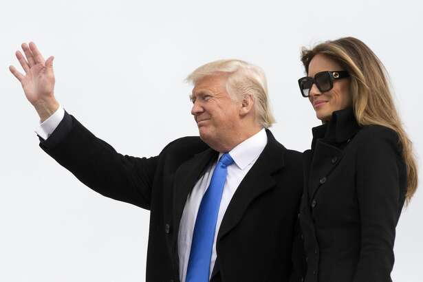 President-elect of The United States Donald J. Trump and first Lady-elect Melania Trump arrive at Joint Base Andrews the day before his swearing in January 19, 2017 in Maryland. Hundreds of thousands of people are expected to come to the National Mall to witness Trump being sworn in as the 45th president of the United States. (Photo by Chris Kleponis-Pool/Getty Images)