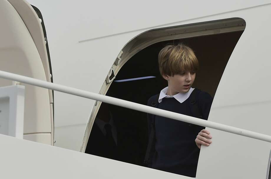 Baron Trump, son of US President-elect Donald Trump, steps off a plane upon arrival at Andrews Air Force Base in Maryland on January 19, 2017. Photo: MANDEL NGAN/AFP/Getty Images
