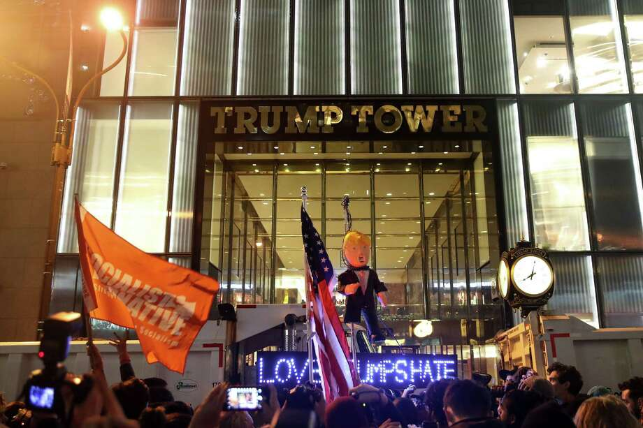NEW YORK, NY - NOVEMBER 9: Hundreds of protestors rallying against Donald Trump gather outside of Trump Tower, November 9, 2016 in New York City. Republican candidate Donald Trump won the 2016 presidential election in the early hours of the morning in a widely unforeseen upset. (Photo by Drew Angerer/Getty Images) Photo: Drew Angerer / Getty Images / 2016 Getty Images