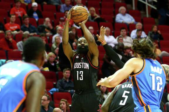 Houston Rockets guard James Harden (13) shoots a  three-point shot during the first quarter of an NBA game at the Toyota Center, Thursday, Jan. 5, 2017, in Houston. ( Jon Shapley / Houston Chronicle )