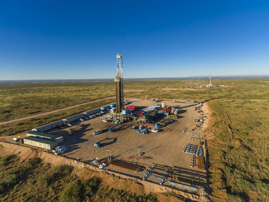 WPX Energy, Delaware basin. Three drilling rigs on multi-well pads. L to R: Orion Drilling, Phoenix on the CBR 22-17H, Pegasus on the CBR 22-10H,  Aries on the CBR 22-14H. Photo: Jim Blecha, Courtesy WPX