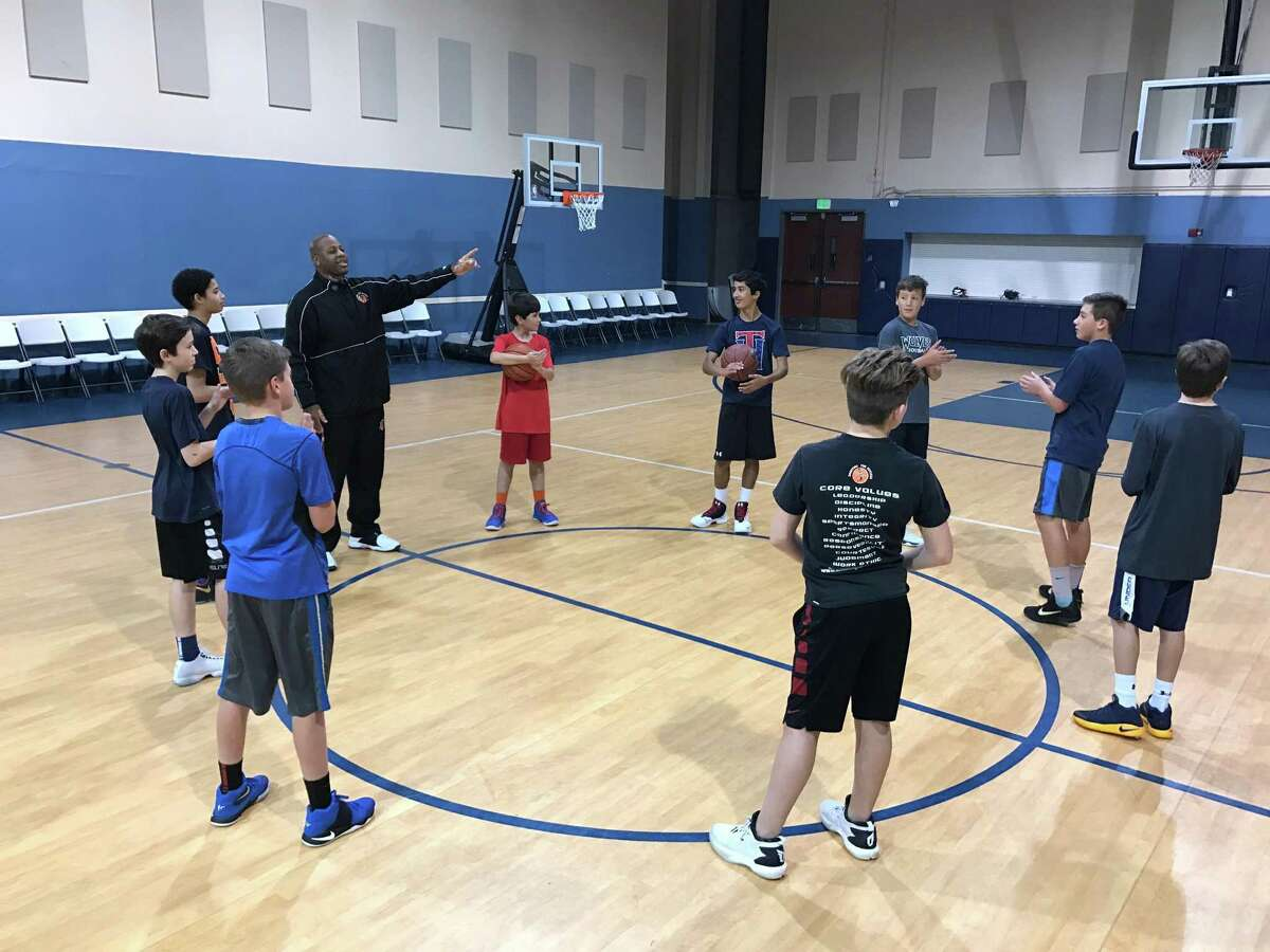 """Former professional basketball player David """"DJ"""" Jones leads practice on a recent night. Jones, who played 10 years in Europe, operates the """"Shooting fFor Success"""" program on the North Side."""
