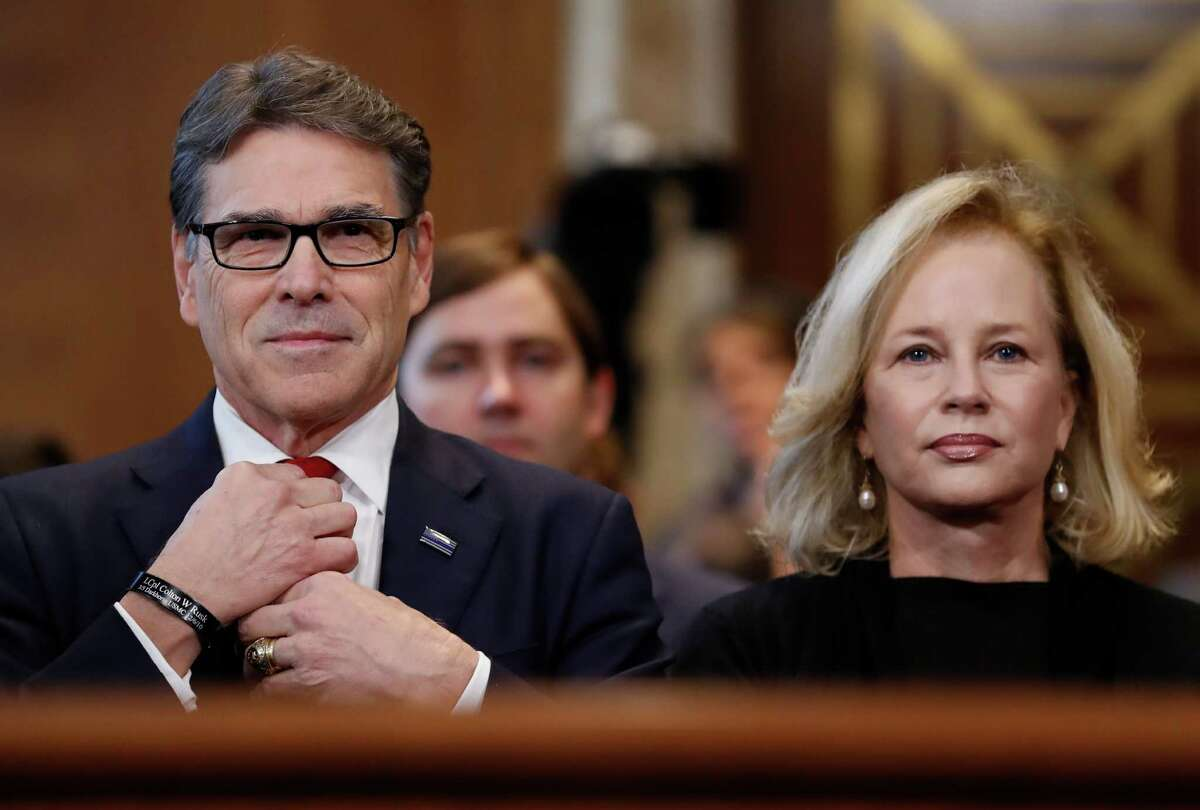Energy Secretary-designate Rick Perry, accompanied by his wife Anita, straightens his tie prior testifying on Capitol Hill in Washington, Thursday, Jan. 19, 2017, at his confirmation hearing before the Senate Energy and Natural Resources Committee. (AP Photo/Carolyn Kaster)