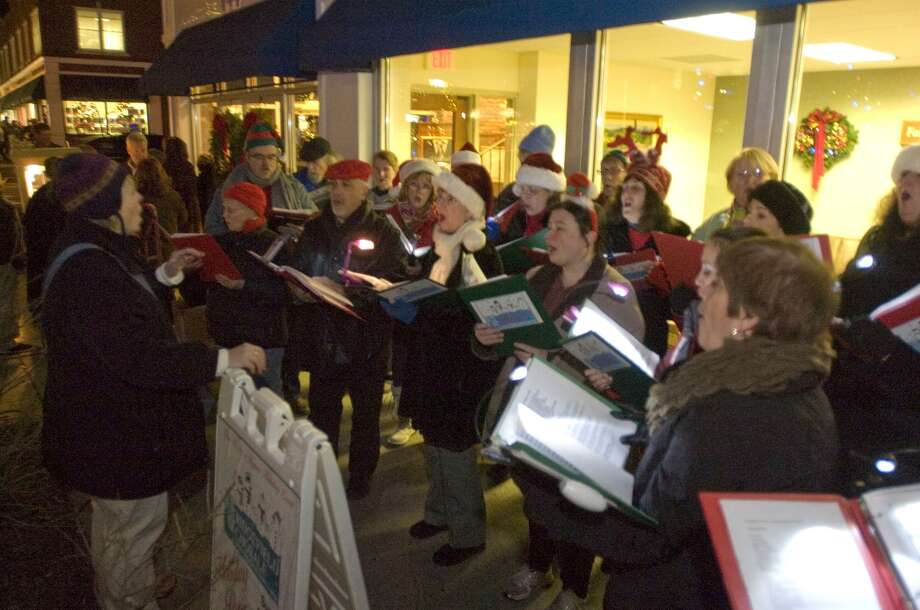 Members of the Ridgefield Chorale sing for passersby during the 12th annual Holiday Stroll in Ridgefield on Friday, Dec. 2, 2011. Photo: Jason Rearick / Jason Rearick / The News-Times