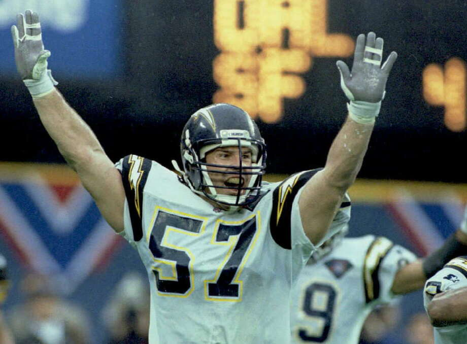 PITTSBURGH, UNITED STATES:  San Diego Chargers' Dennis Gibson celebrates after breaking up a pass 15 January intended for Pittsburgh Steelers' Barry Foster on the Steelers' final offensive play of the AFC Championship game in Pittsburgh, Pennsylvania. The Chargers' won the game 17-13 and will play in Super Bowl XXIX 29 January in Miami, Florida.(COLOR KEY:Helmets blue) AFP PHOTO (Photo credit should read JEFF HAYNES/AFP/Getty Images) Photo: JEFF HAYNES/AFP/Getty Images