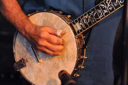 Paul Jossman plays the banjo with the Ramblin Jug Stompers in June 2016 at McGeary's in Albany. (Lori Van Buren / Times Union)