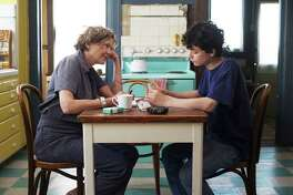 """This image released by A24 shows Annette Bening, left, and Lucas Zade Zumann in """"20th Century Women."""" (Merrick Morton/A24 via AP) ORG XMIT: NYET523"""