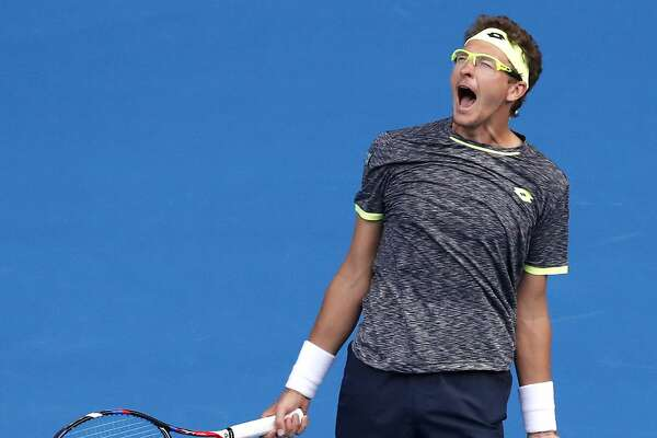 Uzbekistan's Denis Istomin celebrates his win over Serbia's Novak Djokovic during their second round match at the Australian Open tennis championships in Melbourne, Australia, Thursday, Jan. 19, 2017. (AP Photo/Kin Cheung)