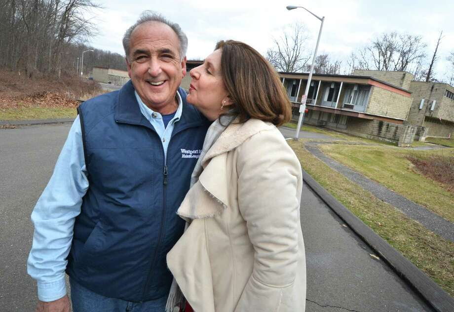Robin and Vincent Penna, share a hug and a kiss in front of the new home for their family business, A.J. Penna and Son, the State of Connecticut Armory property on New Canaan Ave. on Thursday January 19, 2017 in Norwalk Conn. The state has taken the property where their business currently operates from on Goldstein Place in Norwalk for construction of the Walk Bridge project over the Norwalk River. Photo: Alex Von Kleydorff / Hearst Connecticut Media / Connecticut Post
