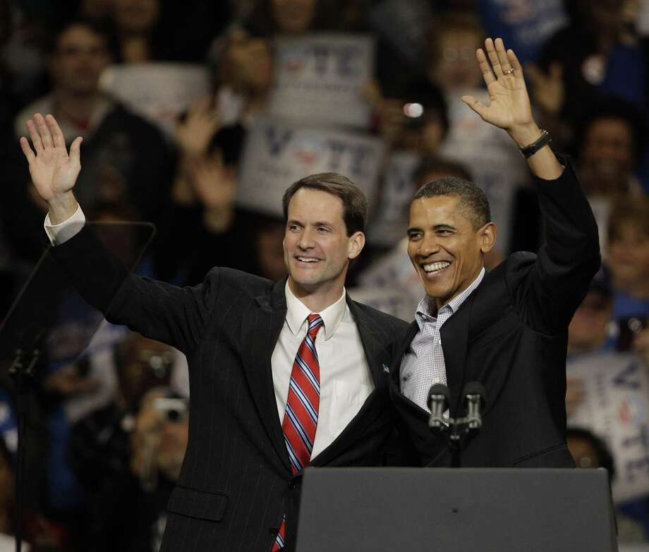 President Barack Obama stands with Democratic candidate for the 4th Congressional District Jim Himes at the start of a rally to get-out-the-vote for Democratic candidates in Bridgeport, Conn., Saturday afternoon, Oct. 30, 2010. Photo: Stephan Savoia / AP Photo/Stephan Savoia / Associated Press