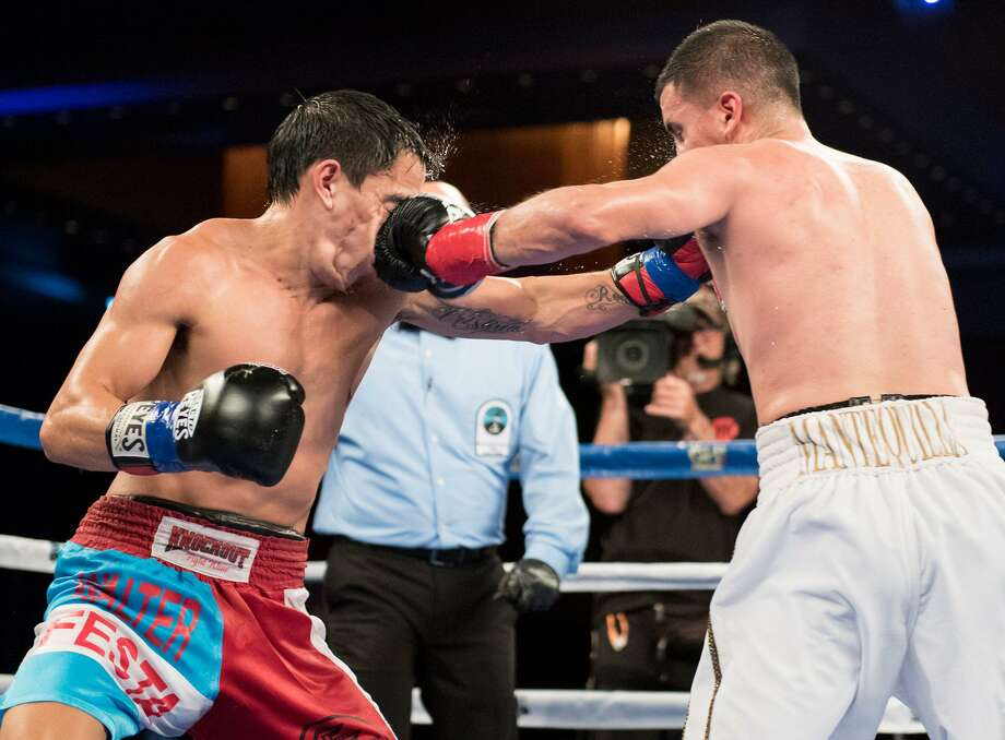 San Antonio boxer Adam Lopez (right) fights in 2016. Photo: Courtesy Photo /Matthew Heasley