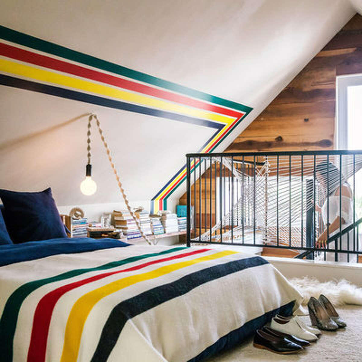 Play with paint For this attic bedroom, artist Windy Chien and her husband took inspiration from a classic Pendleton blanket (from $199) to create a preppy, punchy wall treatment. To get the look on your own wall, use a laser level to measure and tape the top and bottom borders, 1 foot at a time; then start painting, beginning with the darkest color, allowing paint to dry between coats.