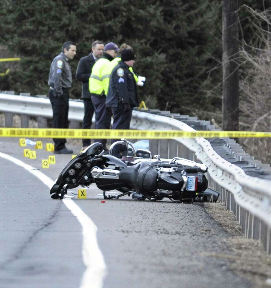 Police investigate a motorcycle accident on Mount Pleasant Road near Reservoir Road in Newtown, Conn, on Thursday afternoon, January 19, 2017. Photo: H John Voorhees III / Hearst Connecticut Media / The News-Times