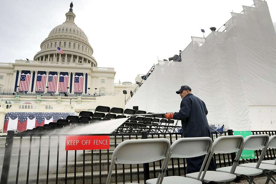 WASHINGTON, DC - JANUARY 19:  Architect of the Capitol Stone Mason Division employee Romel Lazo uses a power washer to clean the West Front of the U.S. Capitol one day before the inaguration of Donald Trump January 19, 2017 in Washington, DC. Hundreds of thousands of people are expected to come to the National Mall to witness Trump being sworn in as the 45th president of the United States.  (Photo by Chip Somodevilla/Getty Images) Photo: Chip Somodevilla, Getty Images