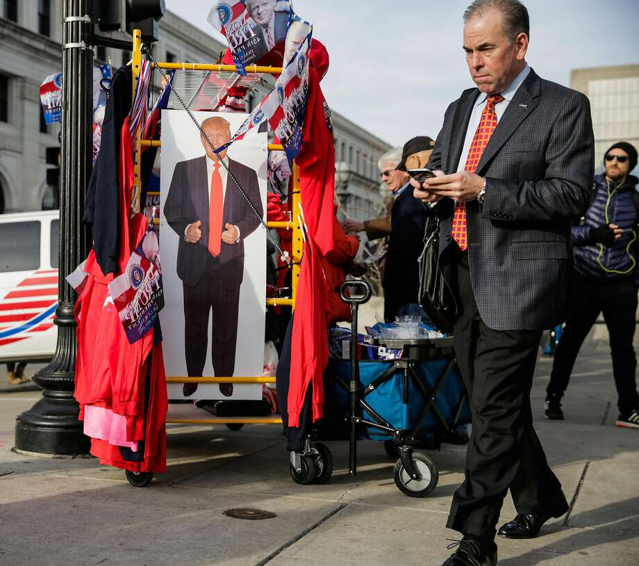 A man walks past a stand displaying Donald Trump paraphernalia outside Union Station in Washington a day before Trump becomes the 45th president of the United States. Photo: Gabrielle Lurie, The Chronicle