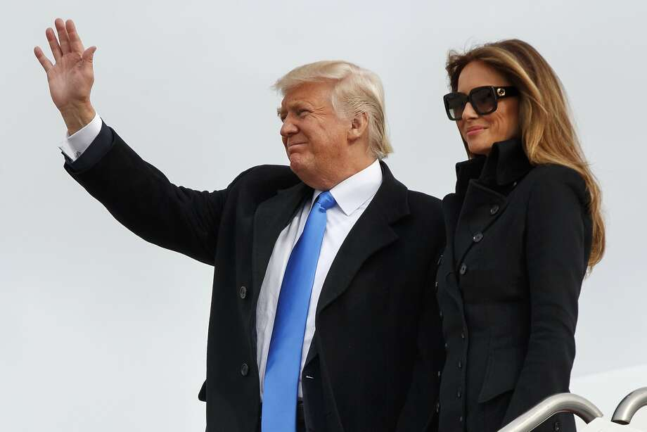 Donald Trump, accompanied by wife Melania, arrives at Andrews Air Force Base. Photo: Evan Vucci, Associated Press