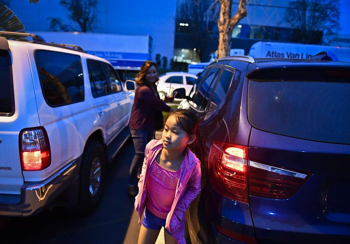 Newly elected San Francisco Chamber of Commerce President Tallia Hart, rear, and her daughter Lola Bodenhamer, 9, front, get out of the car to outside of Lola's gymnastics practice Wednesday evening. Newly elected San Francisco Chamber of Commerce President Tallia Hart and her daughter Lola Bodenhamer, 9, at their home and gymnastics practice on Wednesday, Jan. 18, 2017 in Trabuco Canyon, Calif.