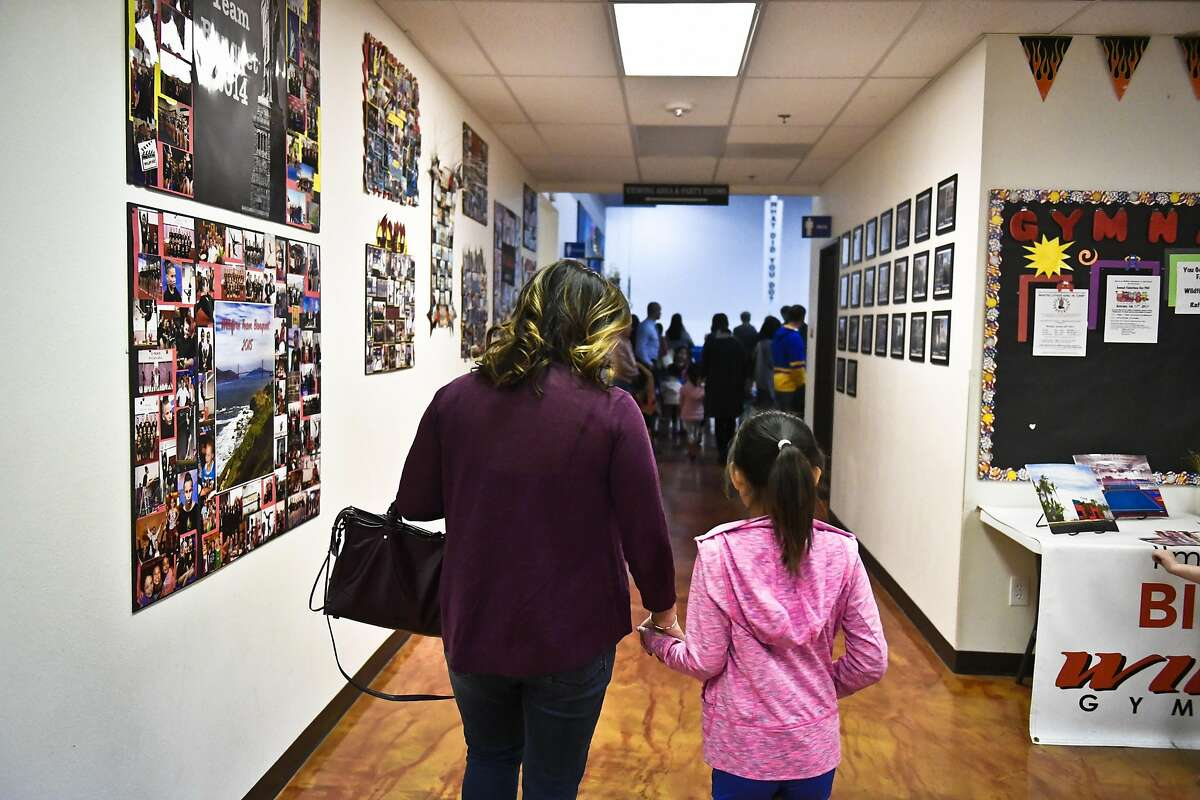 Tallia Hart left, and her daughter Lola Bodenhamer, 9, right, before Lola's gymnastics practice Wednesday evening. Newly elected San Francisco Chamber of Commerce President Tallia Hart and her daughter Lola Bodenhamer, 9, at their home and gymnastics practice on Wednesday, Jan. 18, 2017 in Trabuco Canyon, Calif.
