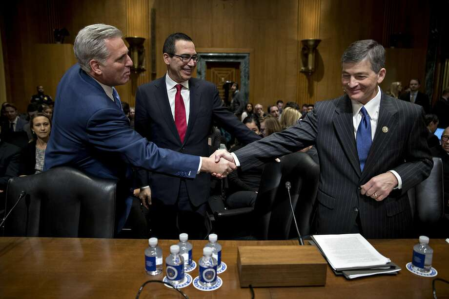 Representative Jeb Hensarling, a Republican from Texas and chairman of the House Financial Services Committee, right, shakes hands with House Majority Leader Kevin McCarthy, a Republican from California, in front of Steven Mnuchin, Treasury secretary nominee for president-elect Donald Trump, during a Senate Finance Committee confirmation hearing in Washington, D.C., U.S., on Thursday, Jan. 19, 2017. Mnuchin defended his record as an owner of a mortgage lender that was accused of unfair loan and foreclosure practices during the financial crisis. Photographer: Andrew Harrer/Bloomberg Photo: Andrew Harrer, Bloomberg