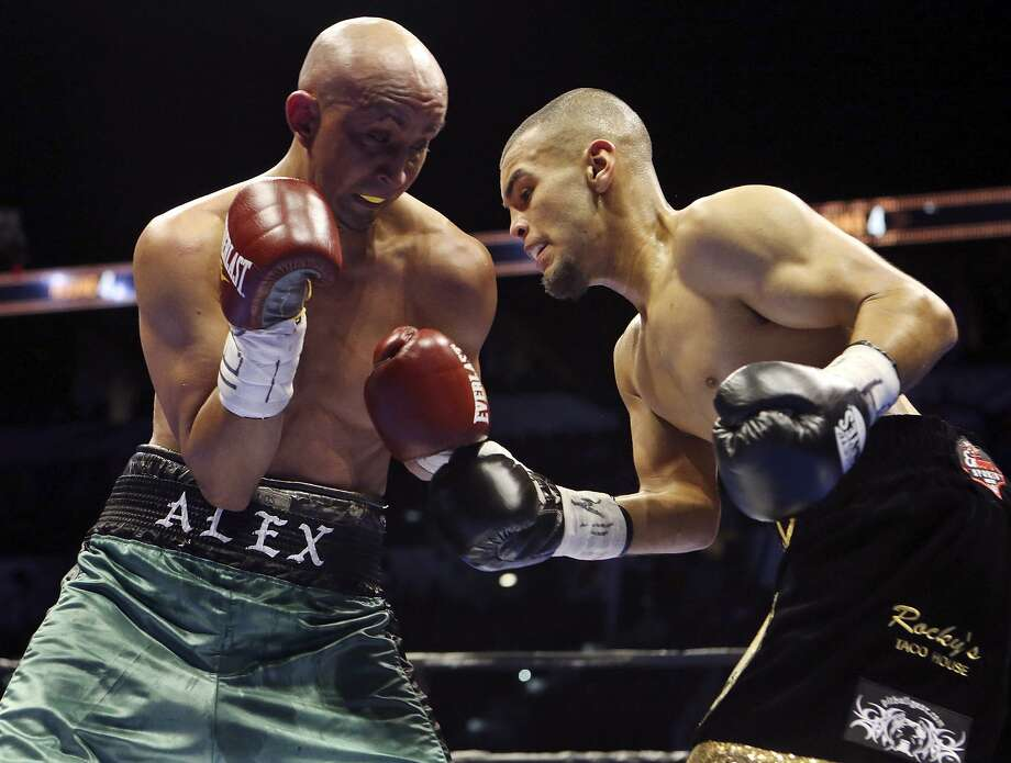 Alejandro Moreno (left) and Javier Rodriguez exchange punches during their super bantamweight bout part of the Premier Boxing Champions card on Dec. 12, 2015 at the AT&T Center. Rodriguez won by unanimous decision. Photo: Edward A. Ornelas /San Antonio Express-News / © 2015 San Antonio Express-News