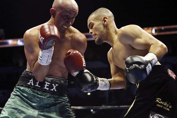 Alejandro Moreno (left) and Javier Rodriguez exchange punches during their super bantamweight bout part of the Premier Boxing Champions card on Dec. 12, 2015 at the AT&T Center. Rodriguez won by unanimous decision.