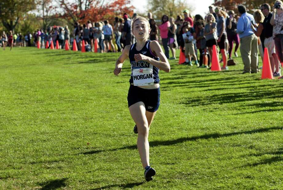 Wilton's Morgan McCormick crosses the finish line in FCIAC Girls Cross Country Championship race action at Wavenly Park in New Canaan, Conn. on Wednesday Oct. 19, 2016. Photo: Christian Abraham / Hearst Connecticut Media / Connecticut Post