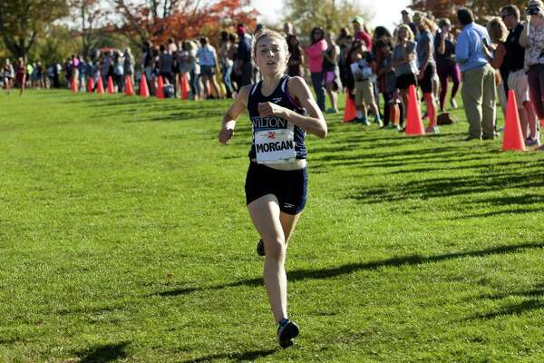 Wilton's Morgan McCormick crosses the finish line in FCIAC Girls Cross Country Championship race action at Wavenly Park in New Canaan, Conn. on Wednesday Oct. 19, 2016.