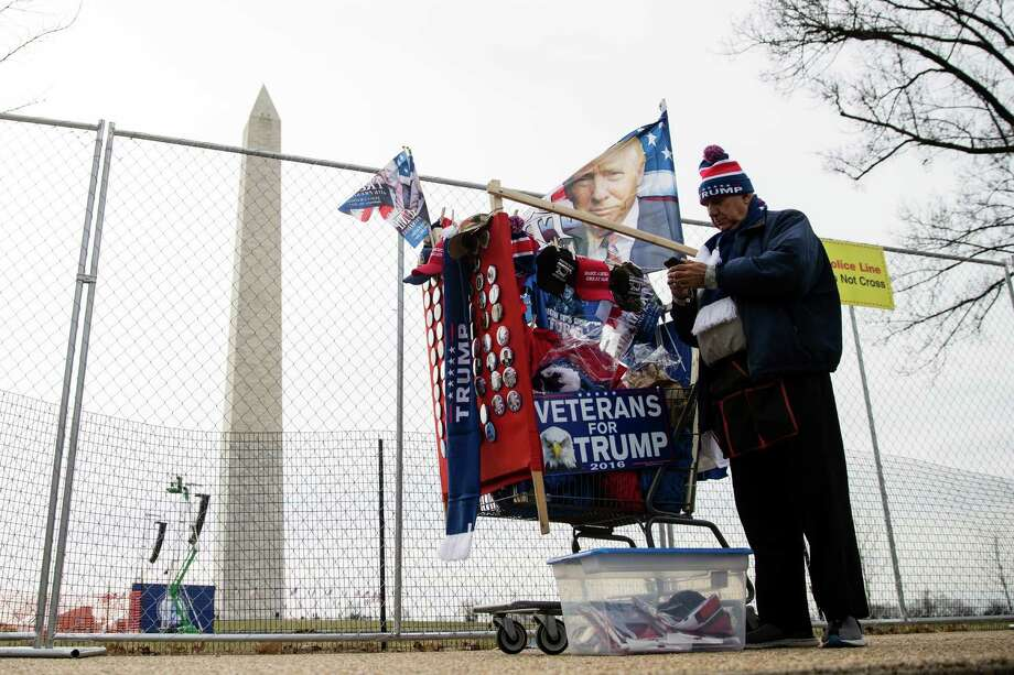 A vendor waits for customers near the Washington Monument in Washington, Thursday, Jan. 19, 2017, ahead of Friday's inauguration of Donald Trump. Photo: Matt Rourke, AP / Copyright 2017 The Associated Press. All rights reserved.