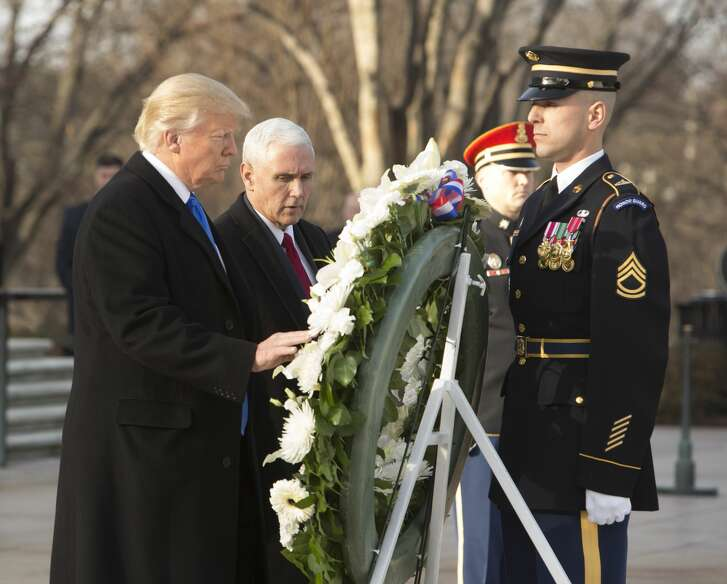President-elect Donald J. Trump and US Vice President-elect Mike Pence participate in a wreath laying ceremony at Arlington National Cemetery on January 19, 2017 in Arlington, Virginia. Hundreds of thousands of people are expected to come to the National Mall to witness Trump being sworn in as the 45th president of the United States. (Photo by Chris Kleponis-Pool/Getty Images)
