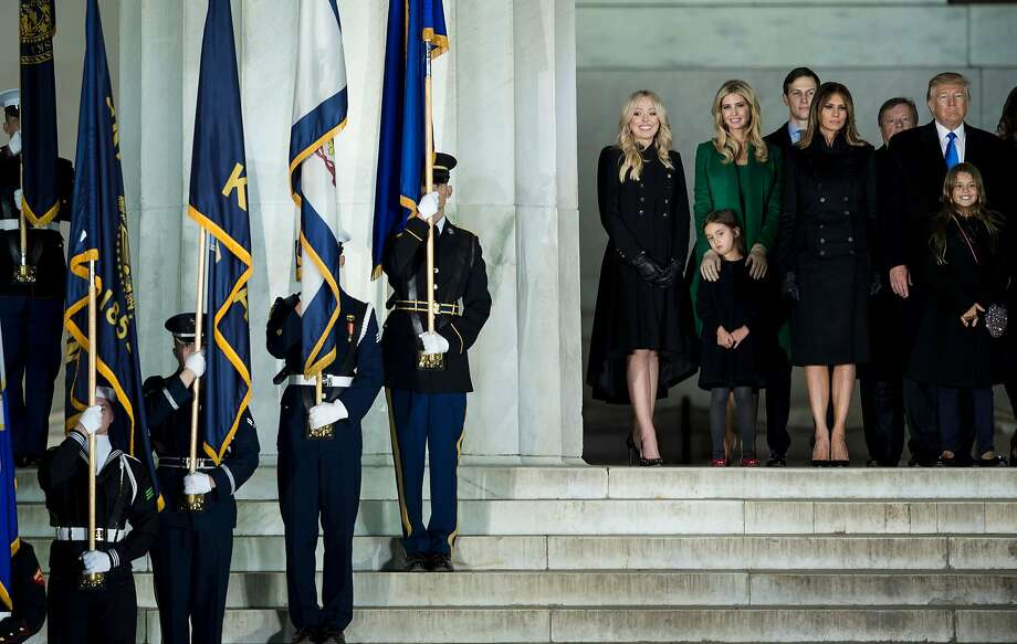 US President-elect Donald Trump (R) looks on with his family at the end of a welcome celebration at the Lincoln Memorial in Washington, DC, on January 19, 2017. He will be sworn in as the nation's 45th president on Friday, Jan. 20, 2017./ AFP PHOTO / Brendan SmialowskiBRENDAN SMIALOWSKI/AFP/Getty Images Photo: BRENDAN SMIALOWSKI, AFP/Getty Images