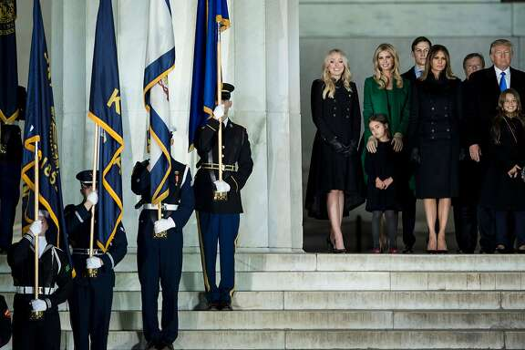 US President-elect Donald Trump (R) looks on with his family at the end of a welcome celebration at the Lincoln Memorial in Washington, DC, on January 19, 2017. / AFP PHOTO / Brendan SmialowskiBRENDAN SMIALOWSKI/AFP/Getty Images