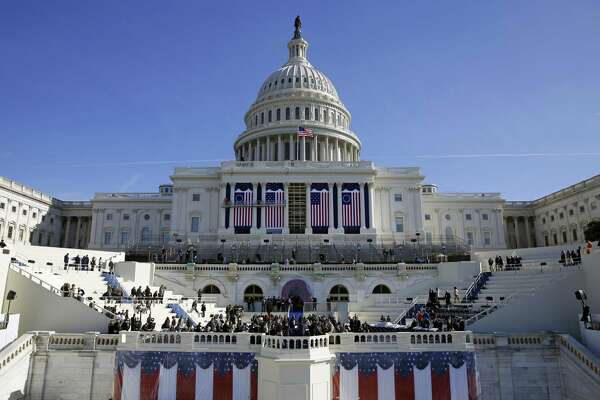 In this Jan. 15, 2016, photo, the U.S. Capitol frames the backdrop over the stage during a rehearsal of President-elect Donald Trump's swearing-in ceremony in Washington. Let's judge him on what he does.