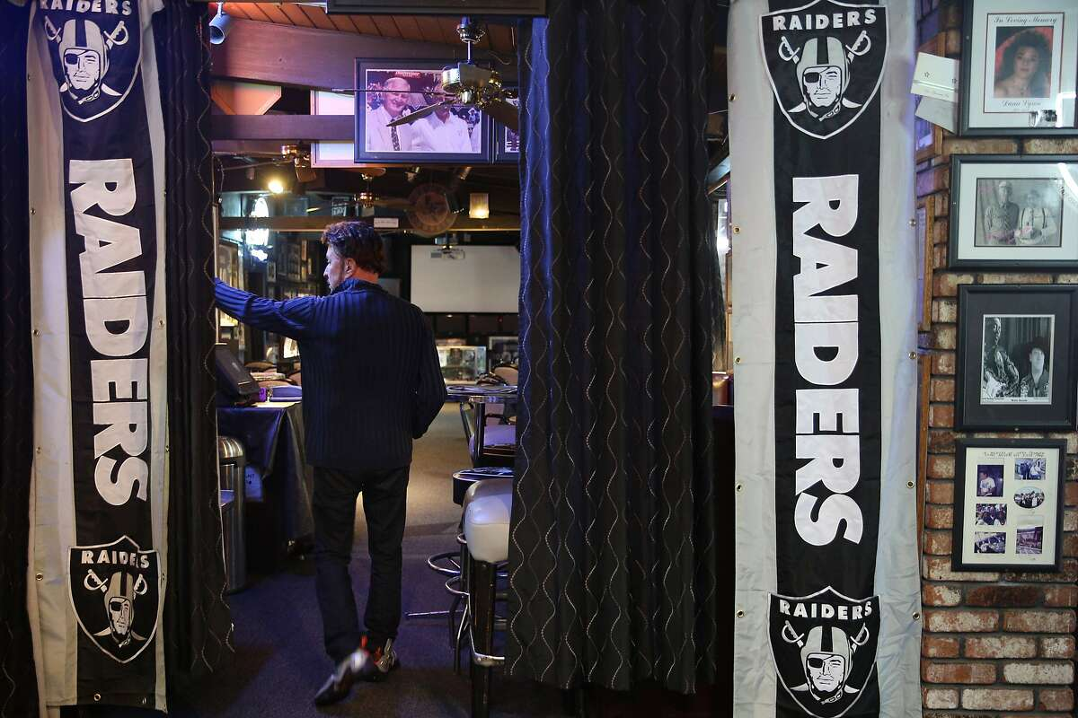 Ricky Ricardo, the business owner, walks inside Ricky's Sports Theatre and Grill on Thursday, Jan. 19, 2017 in San Leandro, Calif.