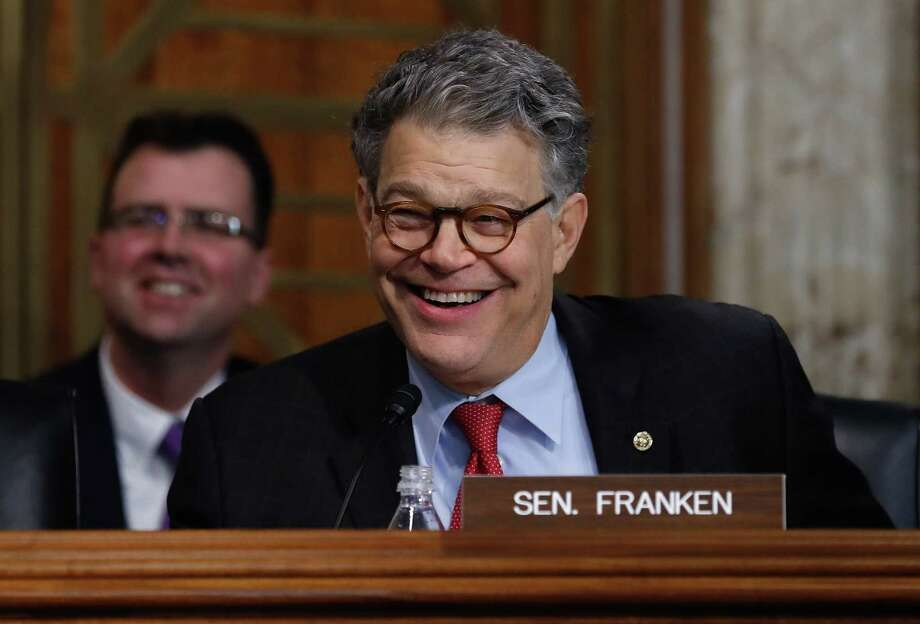 Senate Energy and Natural Resources Committee member Sen. Al Franken, D-Minn. laughs as he asks questions of and jokes with Energy Secretary-designate, former Texas Gov. Rick Perry on Capitol Hill in Washington, Thursday, Jan. 19, 2017, at Perry's confirmation hearing before the committee. (AP Photo/Carolyn Kaster) Photo: Carolyn Kaster, STF / Copyright 2017 The Associated Press. All rights reserved.
