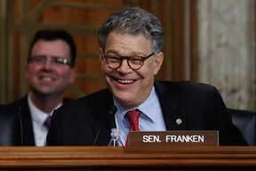 Senate Energy and Natural Resources Committee member Sen. Al Franken, D-Minn. laughs as he asks questions of and jokes with Energy Secretary-designate, former Texas Gov. Rick Perry on Capitol Hill in Washington, Thursday, Jan. 19, 2017, at Perry's confirmation hearing before the committee. (AP Photo/Carolyn Kaster)