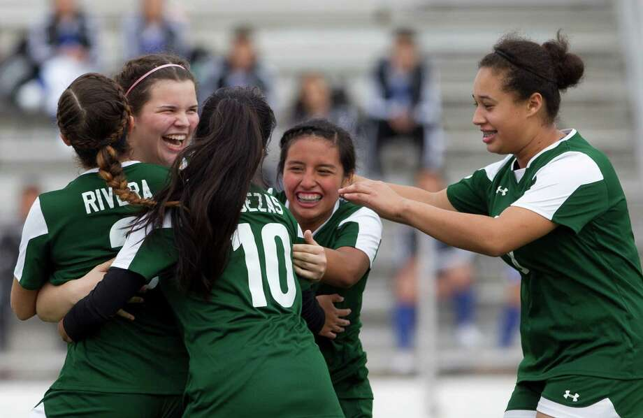 Spring's Caliegh Dauth (17) is mobbed by teammates after scoring the winning penalty kick goal during a match in the Spring ISD girls soccer tournament at Leonard George Stadium Thursday, Jan. 19, 2017, in Spring. Spring defeated Caney Creek 5-4 in penalty kicks. Photo: Jason Fochtman, Staff Photographer / Houston Chronicle