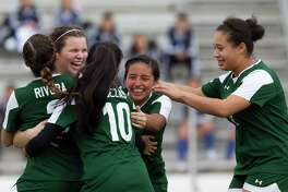 Spring's Caliegh Dauth (17) is mobbed by teammates after scoring the winning penalty kick goal during a match in the Spring ISD girls soccer tournament at Leonard George Stadium Thursday, Jan. 19, 2017, in Spring. Spring defeated Caney Creek 5-4 in penalty kicks.